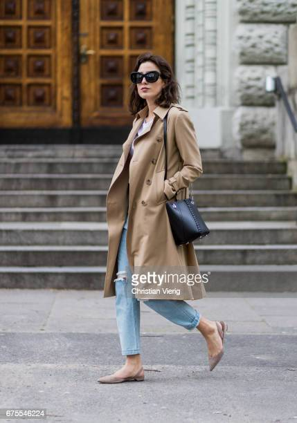 Sylvia Haghjoo wearing a beige Sandro trench coat denim jeans Georgia Alice von Trapp Celine sunglasses flats Paul Andrew Proenza Shouler bag on May...