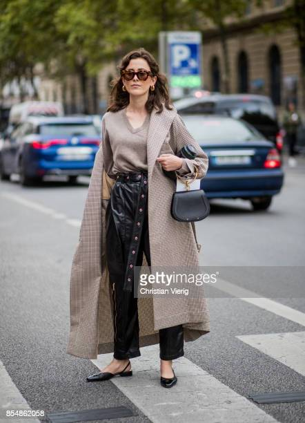 Sylvia Haghjoo wearing a trench coat Chloe bag is seen outside Dries van Noten during Paris Fashion Week Spring/Summer 2018 on September 27 2017 in...