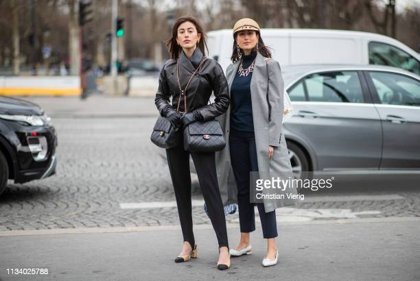 Sylvia Haghjoo wearing black leather jacket two Chanel bags and Julia Haghjoo is seen wearing hat outside Chanel during Paris Fashion Week Womenswear...