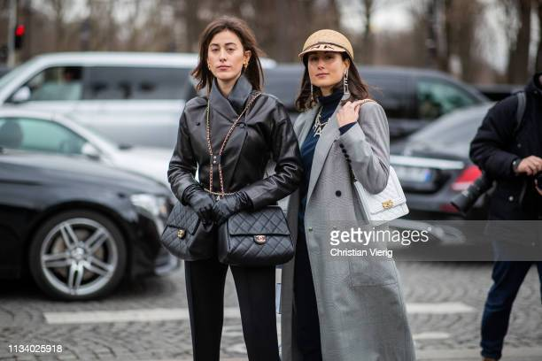 Sylvia Haghjoo wearing black leather jacket, two Chanel bags and Julia Haghjoo is seen wearing hat outside Chanel during Paris Fashion Week...