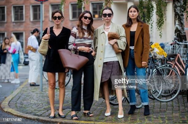 Sylvia Haghjoo wearing black velvet dress Funda Christophersen wearing navy pants brown white striped longshirt Beatrice Gutu is seen wearing trench...