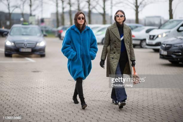 Sylvia Haghjoo wearing blue teddy coat and Julia Haghjoo is seen wearing olive jacket, flared pants outside Munthe during the Copenhagen Fashion Week...