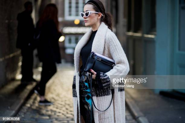 Sylvia Haghjoo wearing cardigan seen outside JW Anderson during London Fashion Week February 2018 on February 17 2018 in London England