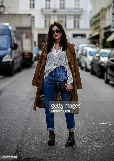 Sylvia Haghjoo wearing Givenchy boots Closed jeans Gestuz blouse Celine sunglasses Louis Vuitton bag Dimitri coat outside Jesper Hovring Great...