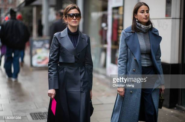Sylvia Haghjoo wearing navy coat and Julia Haghjoo wearing blue double breasted coat is seen outside Christopher Kane during London Fashion Week...