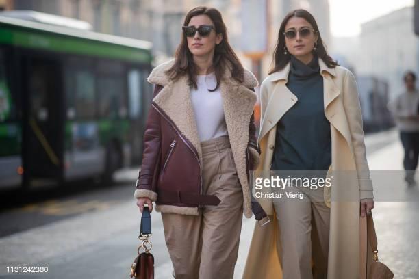 Sylvia Haghjoo wearing shearling jacket, brown high waist pants and Julia Haghjoo wearing beige coat is seen outside Max Mara on Day 2 Milan Fashion...