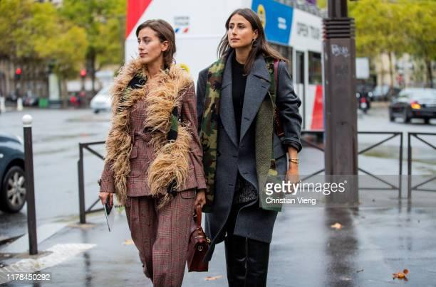 Sylvia Haghjoo wearing suit, beige scarf and Julia Haghjoo wearing camouflage scarf, grey coat seen outside Miu Miu during Paris Fashion Week...