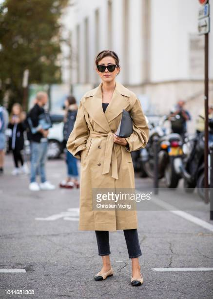 Sylvia Haghjoo wearing two tone trench coat Loewe bag Chanel shoes skinny denim jeans seen outside Sacai during Paris Fashion Week Womenswear...