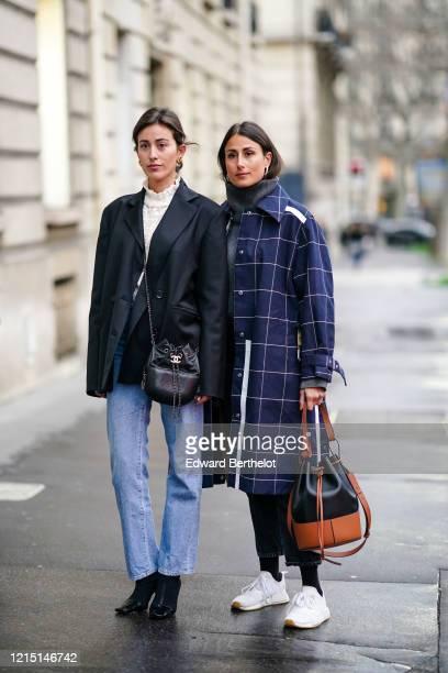 Sylvia Haghjoo wears a white turtleneck ruffled top, a black oversized blazer jacket, a Chanel bag, blue denim jeans pants, pointy shoes ; Julia...