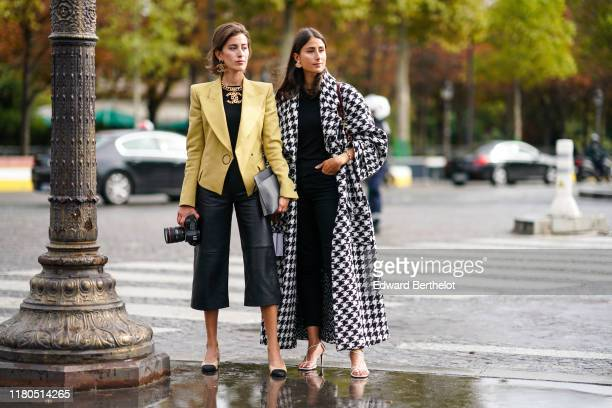 Sylvia Haghjoo wears Chanel earrings a Chanel necklace a yellow jacket a black top black leather widelegs crop pants a grey clutch Chanel slingback...