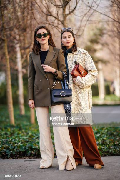 Sylvia Haghjoo wears earrings sunglasses a black top a khaki jacket beige wideleg pants beige alligator pattern pumps a black Chloe bag Julia Haghjoo...