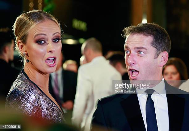Sylvia Jeffreys and Karl Stefanovic react as they arrive at the 57th Annual Logie Awards at Crown Palladium on May 3 2015 in Melbourne Australia