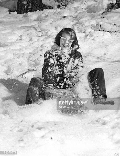JAN 19 1970 FEB 4 1970 Sylvia Kelley 2505 Clermont St gets a face full of snow as she skids through a turn down a track laid out by the Cadettes in...
