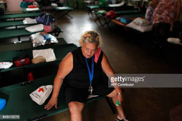 TOPSHOT Sylvia Lamzo sits on a folding bed at an emergency center as Hurricane Irma approaches Puerto Rico in Fajardo on September 6 2017 Irma is...
