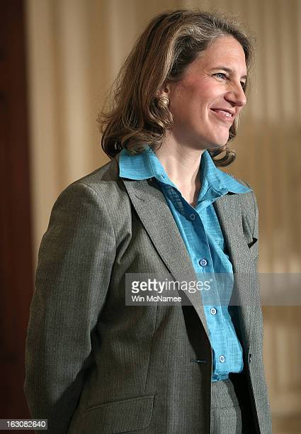 Sylvia Mathews Burwell the President of the Walmart Foundation listens as US President Barack Obama announces her nomination budget director during a...