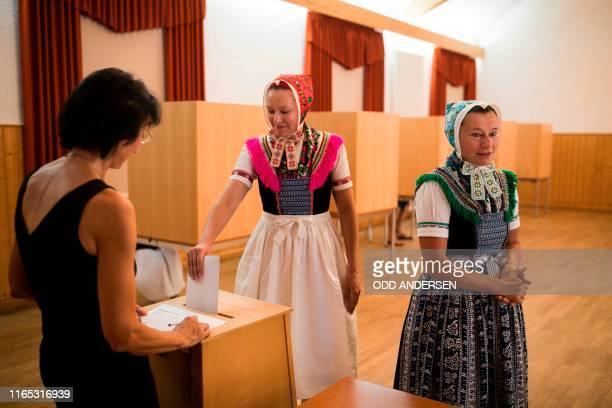 Sylvia Panoscha and her daughter Juliane wearing traditional Sorbian dresses cast their ballots for state elections in Saxony on September 1 2019 in...