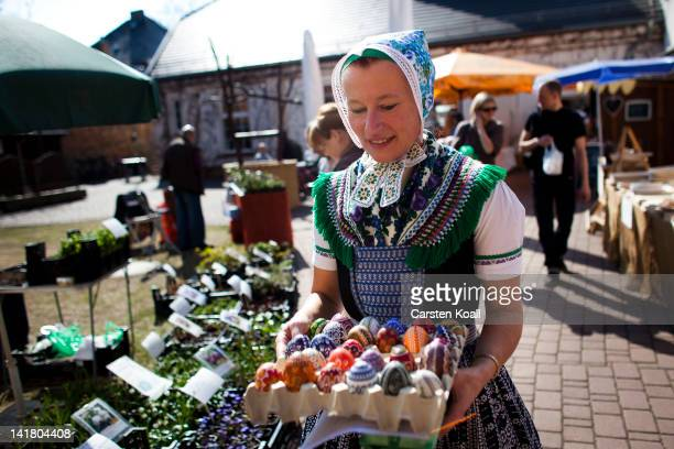 Sylvia Panoscha wearing a traditional Lusatian sorbian folk dress carries a box of eggs painted with traditional sobian motives at the annual...