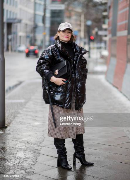 Sylvia Paula Weber wearing black down feather jacket cap midi skirt black boots is seen during the Berlin Fashion Week January 2018 at Bauakademie on...