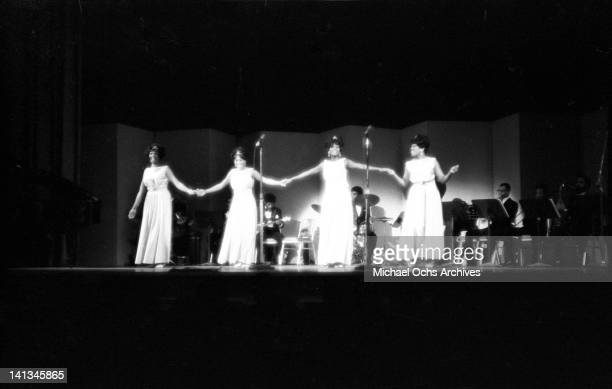 Sylvia Shemwel Myrna Smith Estelle Brown and Cissy Houston of the vocal group 'The Sweet Inspirations' perform onstage on December 31 1968
