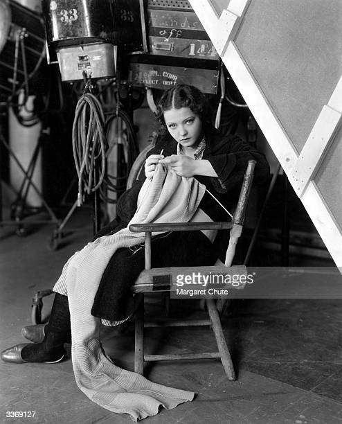 Sylvia Sidney , is viewed between scenes from the filming of 'Ladies Of The Big House', knitting a garment.