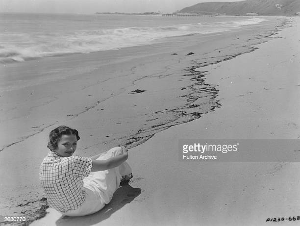 Sylvia Sidney the American film and television actress on the beach in front of her Malibu home where she spends her time when she is not working.