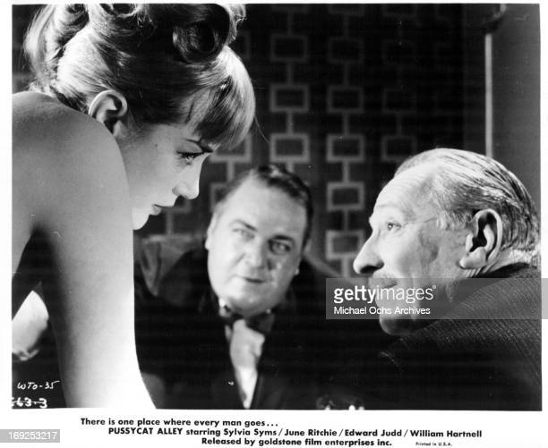 Sylvia Syms approaches a man in a scene from the film 'The World Ten Times Over' 1963 Photo by Goldstone Film/Getty Images