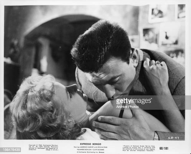 Sylvia Syms is kissed by Laurence Harvey in a scene from the film 'Expresso Bongo' 1959