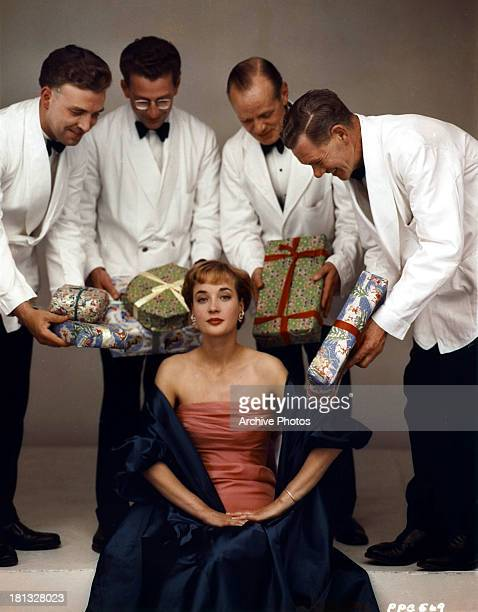 Sylvia Syms receives gifts in publicity portrait, circa 1965.