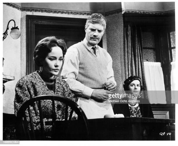 Sylvia Syms sits at a table in a scene from the film 'The Quare Fellow', 1962.