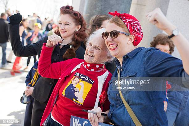 Sylvia Tanis a Rosie the Riveter during World War II poses with guests at the WWII Memorial March 22 2016 Tanis was part of an Honor Flight from...