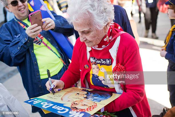 Sylvia Tanis a Rosie the Riveter during World War II signs a poster at the WWII Memorial March 22 2016 Tanis was part of an Honor Flight from Detroit...