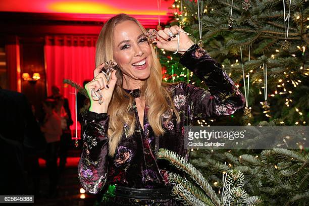 Sylvia Walker decorates the christmas tree during the christmas party at Hotel Vier Jahreszeiten Kempinski on November 24 2016 in Munich Germany