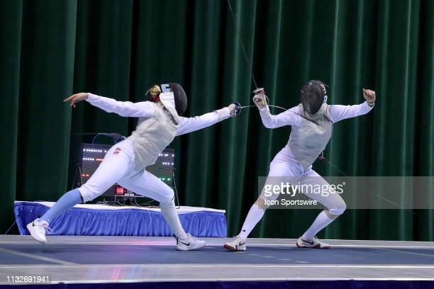 Sylvie Binder of Columbia and Katarzyna Lachman of St John's compete in the championship bout in Women's Foil at the National Collegiate Fencing...