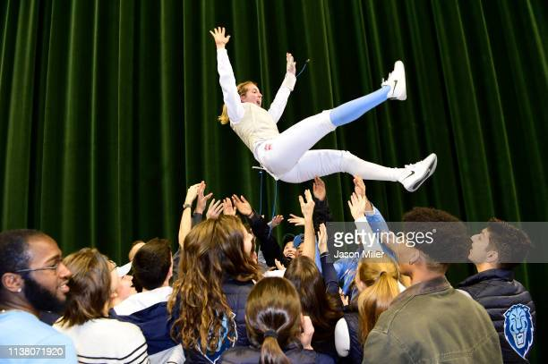 Sylvie Binder of Columbia celebrates with teammates and fans after defeating Katarzyna Lachman of St John's in the Foil National Championship bout...