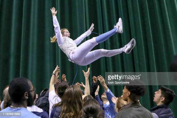 Sylvie Binder of Columbia is tossed into the air by her Columbia fencing teammates after winning the championship in Women's Foil at the National...