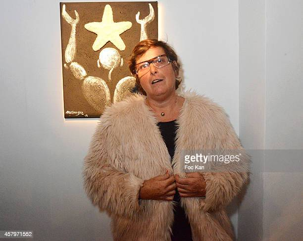 Sylvie Branellec poses with a painting she did with Jerome Mesnager during the 'Skin Fais Moi Ma Peau' Against Women Breast Cancer Auction Exhibition...