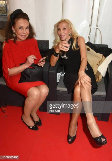 Sylvie Elias and her guest attend The Children for Peace Auction Diner at Jardin des Tuileries on June 25 2019 in Paris France
