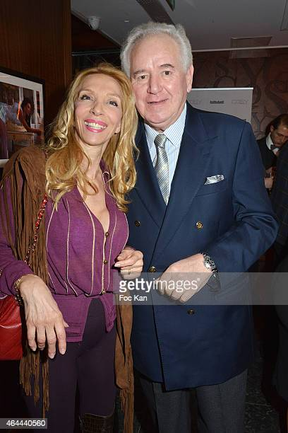 Sylvie Elias and Robert Rossi attend the Massimo Gargia Private photo exhibition dinner party at Le Cosy on February 25 2015 in Paris France