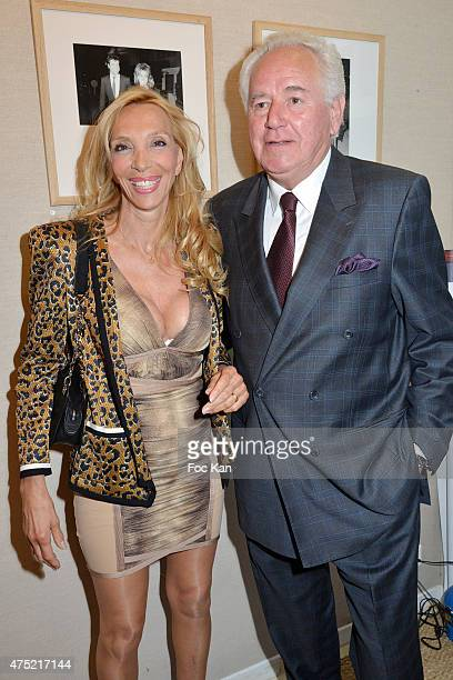 Sylvie Elias Marshall and Robert Rossi attend the 55 portraits of Massimo Gargia Photo Exhibition at Galerie 55 Belchasse on May 29 2015 in Paris...