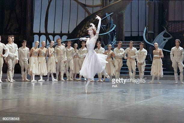 Sylvie Guillem and the dancers of the Ballet of the National Theater of the Opera of Paris in the ballet 'Cendrillon' choreographed by Rudolf Noureev