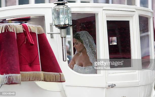 Sylvie Meiss is waiting in the coach for Rafael van der Vaart during their wedding ceremony on June 10, 2005 in Heemskerk, Netherlands.
