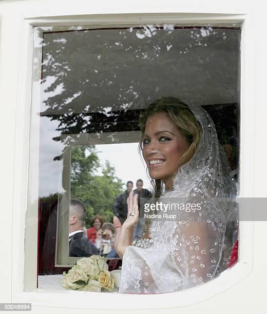 Sylvie Meiss waves in the coach during their wedding ceremony on June 10, 2005 in Heemskerk, Netherlands.