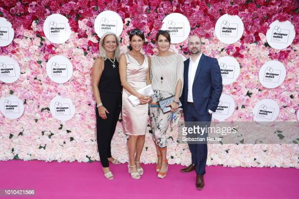 Sylvie Mutschler, Gerit Kling and her sister Anja Kling and Christian Antholz attend the Late Night Shopping at Designer Outlet Soltau on August 3,...