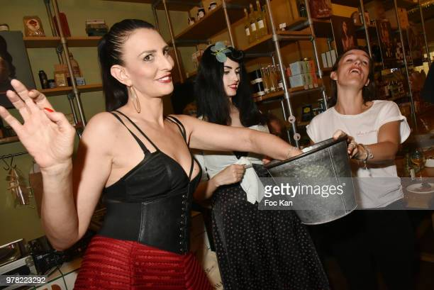 Sylvie Ortega Munos Elsa Oesinger and a guest attend a tombola during the Filles A Cotelettes Party Hosted by Grand Seigneur Magazine at Grocery/Bar...
