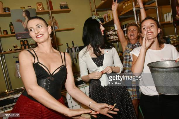 Sylvie Ortega Munos Elsa Oesinger Valerie Mestre from INTERBEV and a guest attend a tombola during the Filles A Cotelettes Party Hosted by Grand...