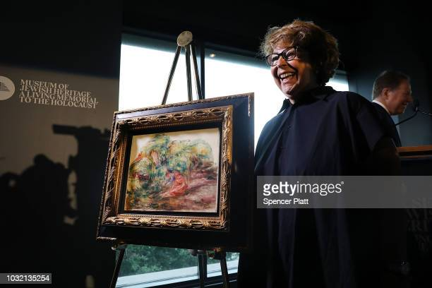 Sylvie Sulitzer poses with the recovered Impressionist painting Two Women in a Garden painted in 1919 by PierreAuguste Renoir on September 12 2018 in...
