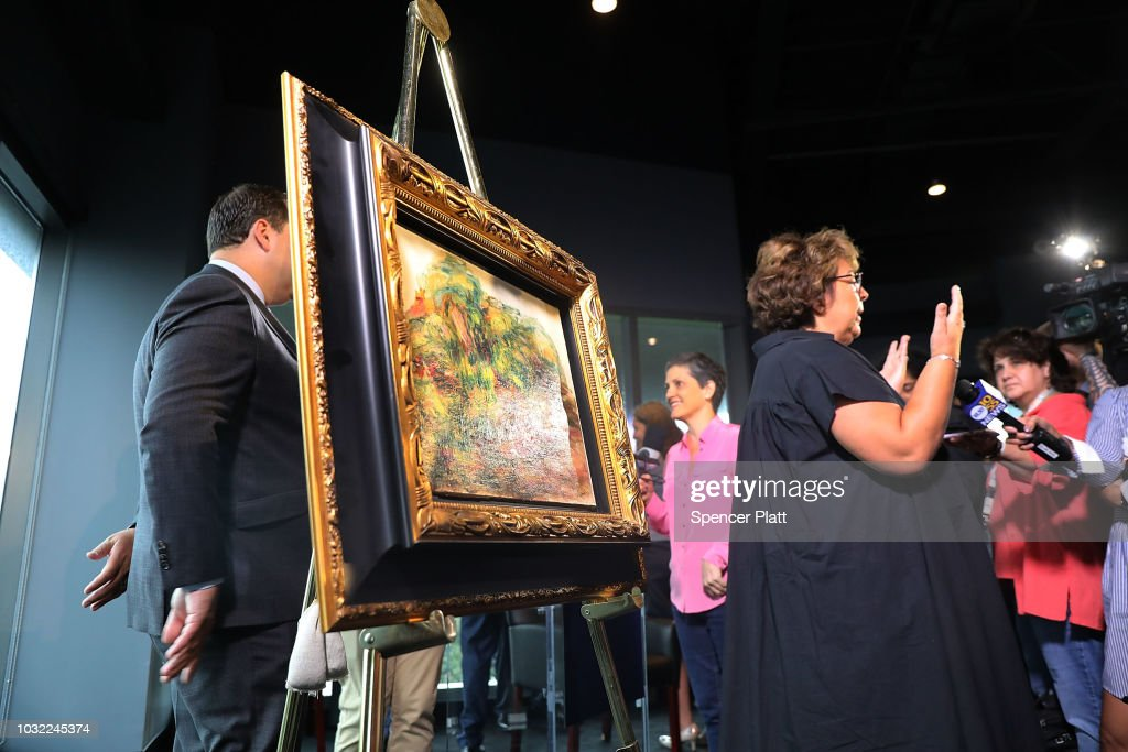 Sylvie Sulitzer speaks to the media beside the recovered Impressionist painting 'Two Women in a Garden,' painted in 1919 by Pierre-Auguste Renoir on September 12, 2018 in New York City. The work of art originally belonged to Sulitzer's grandfather Alfred Weinberger and was stolen by the Nazis in Paris during the World War II. The only living heir, Sylvie Sulitzer became aware of the work in 2013, when the painting had been listed for sale at Christie's in New York. With the Help of the FBI and the United States attorney's office in Manhattan the painting was finally returned to her at a ceremony at the Museum of Jewish Heritage in Lower Manhattan.