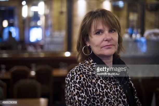 Sylvie Uderzo the daughter of Albert Uderzo coauthor of French comic strip 'Asterix' poses on June 4 2014 at the Vaudeville restaurant in Paris AFP...