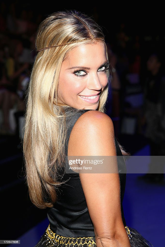 Sylvie van der Vaart attends the Dimitri show during the Mercedes-Benz Fashion Week Spring/Summer 2014 at the Brandenburg Gate on July 3, 2013 in Berlin, Germany.