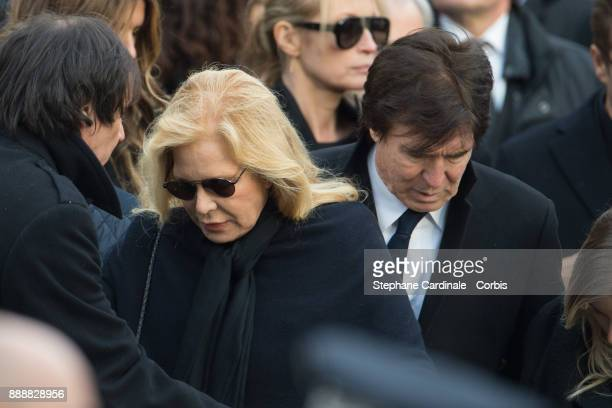 Sylvie Vartan and Tony Scotti are seen after the Johnny Hallyday's Funeral Procession at Eglise De La Madeleine on December 9 2017 in Paris France...
